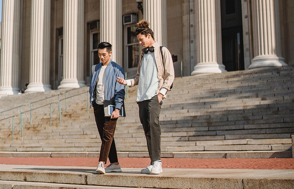 Male Students on Steps of Library